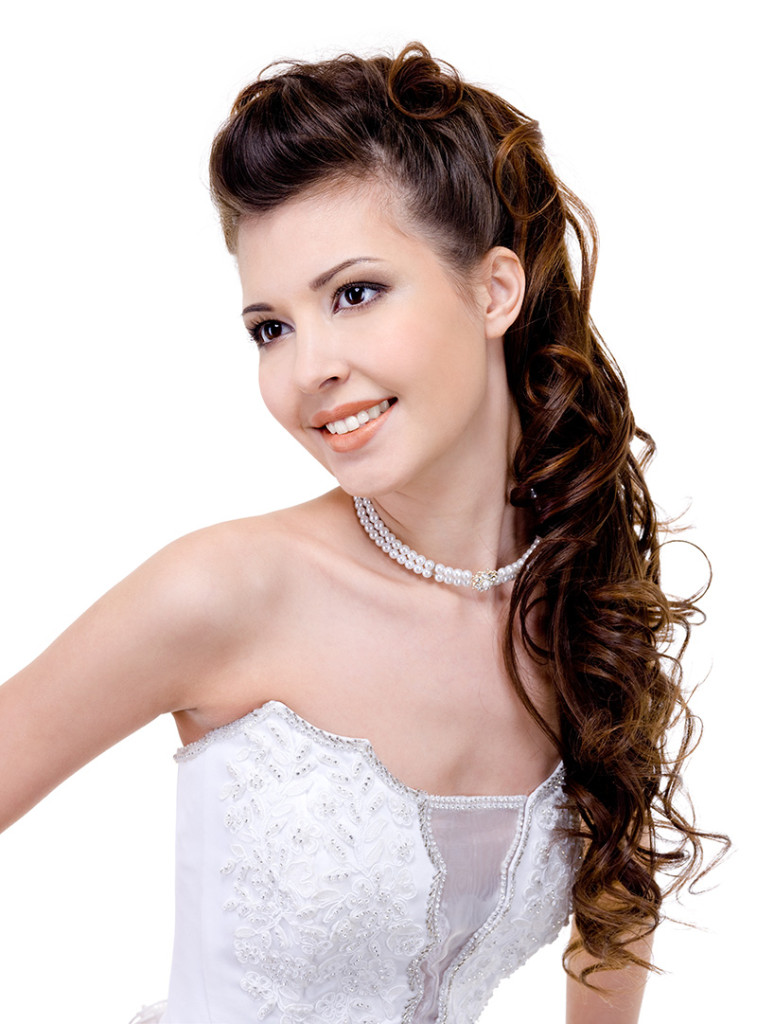 smiling bride with curly wedding hairstyle