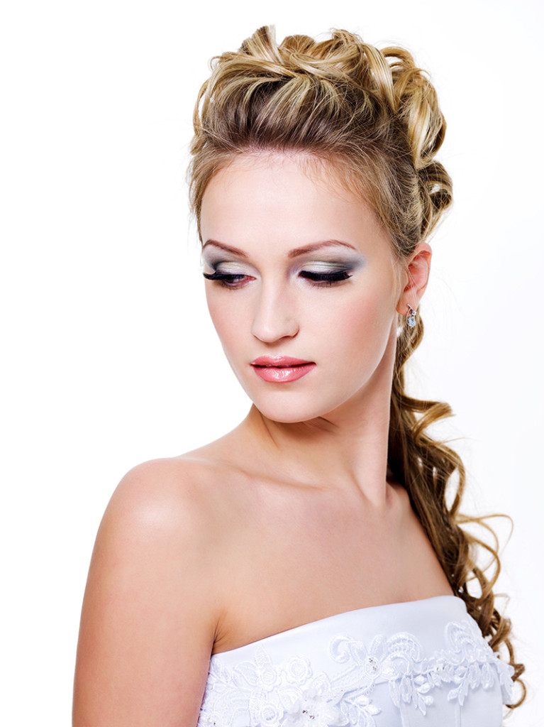 Attractive bride with style wedding hairstyle - isolated